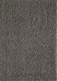 Grijs hoogpolig vloerkleed of karpet